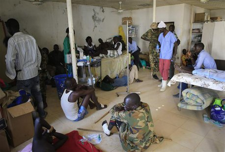 Wounded South Sudan military personnel receive medical treatment at the general military hospital in the capital Juba December 28, 2013. REU