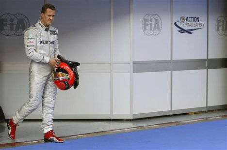 Mercedes Formula One driver Michael Schumacher of Germany walks in parc ferme after the qualifying session of the Malaysian F1 Grand Prix at