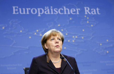 Germany's Chancellor Angela Merkel addresses a news conference at the end of a European Union leaders summit in Brussels December 20, 2013.