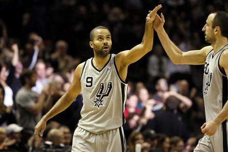 Dec 29, 2013; San Antonio, TX, USA; San Antonio Spurs guard Tony Parker (9) celebrates a score with Manu Ginobili (right) during the second