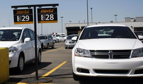 Hertz rental cars are seen in a rental lot near Detroit Metropolitan airport in Romulus, Michigan, May 9, 2011. REUTERS/Rebecca Cook