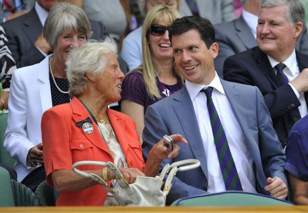 Former British tennis players Anne Jones (L) and Tim Henman talk on Centre Court at the 2010 Wimbledon tennis championships in London, June