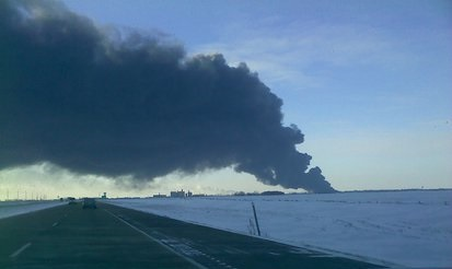 Smoke billows from a fire following a train derailment in Casselton, North Dakota on December 30th, 2013.