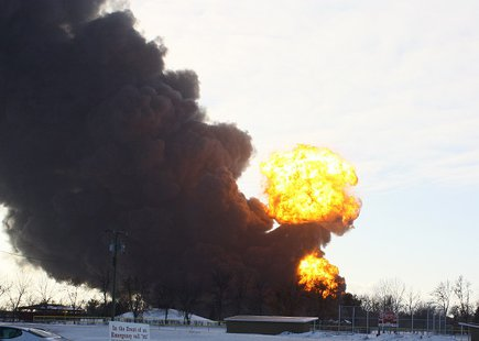 Flames rise from a train derailment in Casselton, North Dakota on December 30th, 2013 Northeast of the explosion on highway 10.