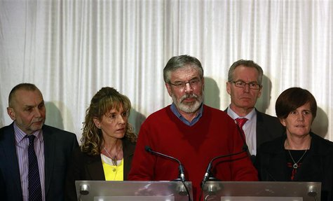 Sinn Fein President Gerry Adams (C) and party colleagues speak to the media in Belfast following the end of talks to resolve divisive issues