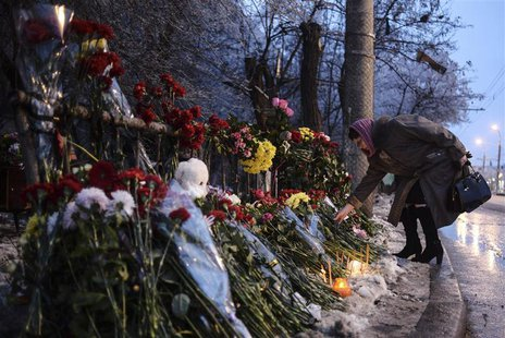 A woman places flowers at the site of an explosion on a trolleybus in Volgograd December 31, 2013. REUTERS/Sergei Karpov