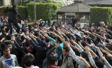 Cairo University students supporting the Muslim Brotherhood and deposed President Mohamed Mursi shout slogans at the university's campus in