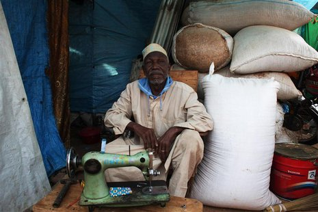 An elderly Muslim man sits in his temporary shop shelter at Ecole Liberte (Freedom School) in Bossangoa, north of the capital Bangui in the