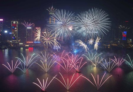 Fireworks explode over Victoria Harbour and Hong Kong Convention and Exhibition Centre during a pyrotechnic show to celebrate the New Year i