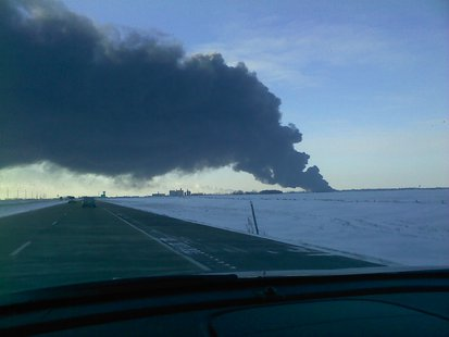 Smoke rising over the horizon of the Casselton derailment (KFGO file photo)