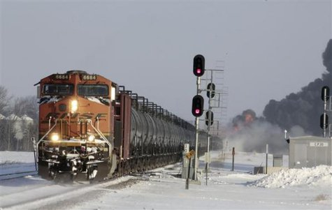A plume of smoke rises from scene of a derailed train near Casselton, North Dakota December 30, 2013. CREDIT: REUTERS/MICHAEL VOSBURG/FORUM NEWS SERVICE