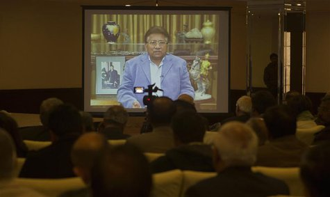 Former Pakistani president Pervez Musharraf is seen during a pre-recorded video statement played for his supporters and members of the media