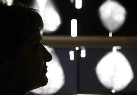 Vasiliki Kostoula, a Greek breast cancer patient, listens to her doctor after a radiological medical examination in an Athens hospital Octob