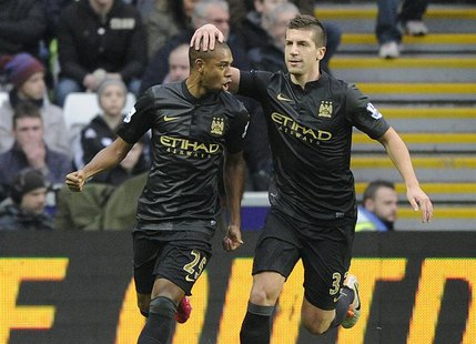 Manchester City's Fernandinho (L) celebrates scoring a goal against Swansea City with Matija Nastasic during their English Premier League so