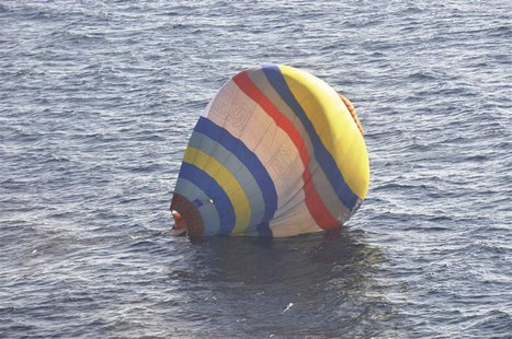A hot-air balloon drifting on the ocean is seen in the East China Sea near the disputed isles known as Senkaku isles in Japan and Diaoyu isl