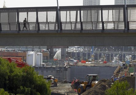 A pedestrian walks over a large construction project for U.S. Customs at the San Ysidro border crossing into the United States in San Ysidro