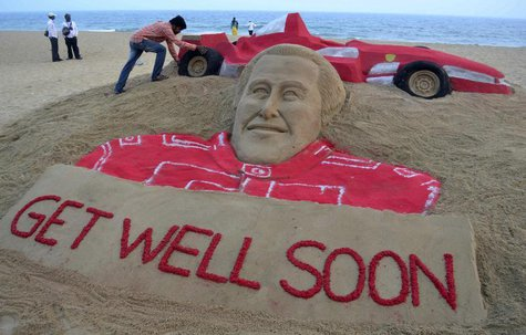 Indian sand artist Sudarshan Pattnaik works on a sand sculpture of seven-times Formula One world champion Michael Schumacher to wish him a s
