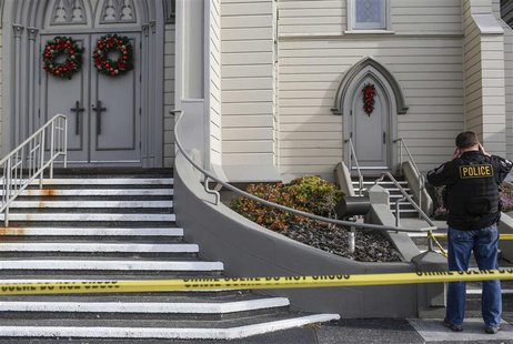 Eureka Police investigate the murder of Reverend Eric Freed outside of St. Bernard Church in Eureka, California on January 1, 2014. REUTERS/