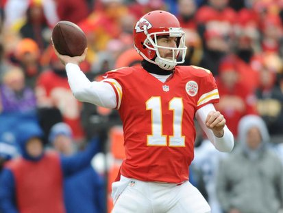 Dec 22, 2013; Kansas City, MO, USA; Kansas City Chiefs quarterback Alex Smith (11) throws a pass during the first half of the game against t