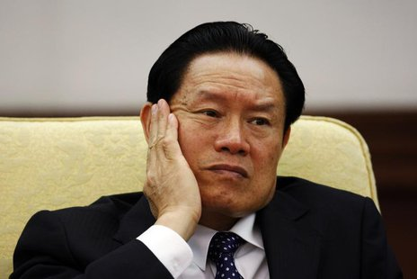 Then China's Public Security Minister Zhou Yongkang reacts as he attends the Hebei delegation discussion sessions at the 17th National Congr