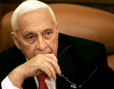 Israeli Prime Minister Ariel Sharon attends a ceremony completing the sale of Bank Leumi to a private U.S. investment group in his office in