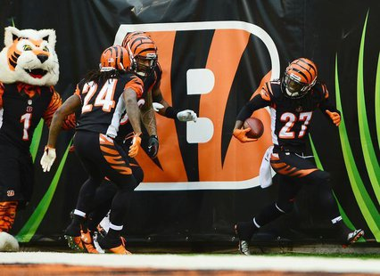 Cincinnati Bengals cornerback Dre Kirkpatrick (27) celebrates with teammates after intercepting a pass and running for a touchdown during th