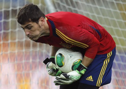 Spain's national soccer team goalkeeper Iker Casillas saves a ball during a training session, ahead of their Confederations Cup soccer match