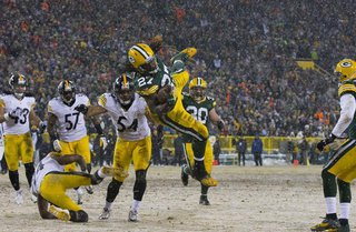 Green Bay Packers running back Eddie Lacy (27) leaps for a touchdown during the first quarter against the Pittsburgh Steelers at Lambeau Fie