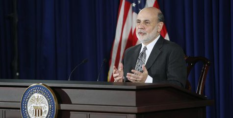 U.S. Federal Reserve Chairman Ben Bernanke responds to reporters during his final planned news conference before his retirement, at the Fede