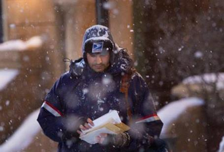 postal carrier in snow