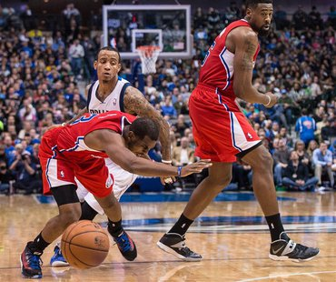 Jan 3, 2014; Dallas, TX, USA; Los Angeles Clippers point guard Chris Paul (3) falls to the court while dribbling past Dallas Mavericks shoot