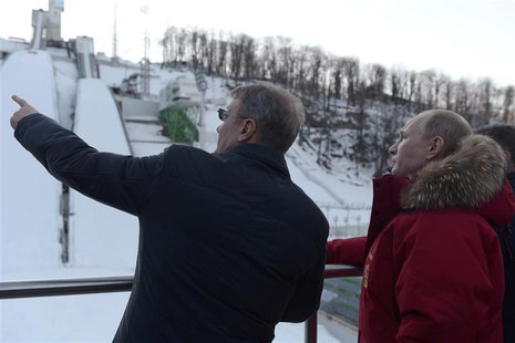 Russian President Vladimir Putin (R) and Sberbank President German Gref (L) visit Olympic venues near Sochi January 3, 2014. REUTERS/Alexei