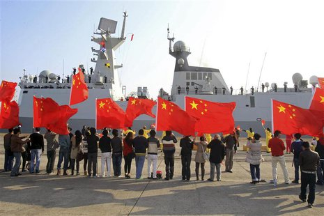 Chinese nationals living in Cyprus wave Chinese national flags as the Chinese frigate Yancheng comes in to dock at Limassol port, January 4,