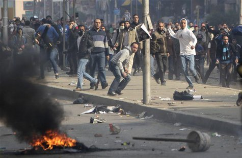 Supporters of Muslim Brotherhood and ousted Egyptian President Mohamed Mursi clash with riot police during clashes at Nasr City district in