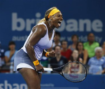 Serena Williams of the U.S. reacts to a won point during her defeat of Belarus' Victoria Azarenka in the women's singles final in the Brisba