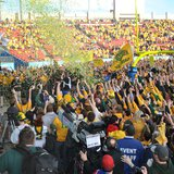 Fans cheer on the NDSU Bison after they stormed the field following the Bison's 3rd straight FCS National Championship January 4th, 2014.