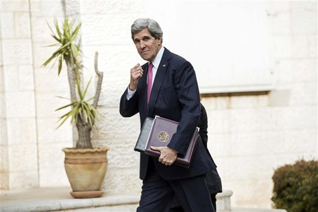 U.S. Secretary of State John Kerry arrives for a meeting at the presidential compound in the West Bank city of Ramallah January 4, 2014. REU