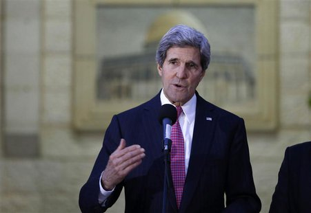 U.S. Secretary of State John Kerry gives a statement to the press after the meeting with Palestinian President Mahmoud Abbas in the West Ban