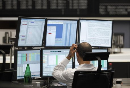 A trader reacts at his desk at the Frankfurt stock exchange August 19, 2011. REUTERS/Alex Domanski