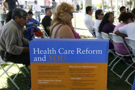 People gather for information during a Planned Parenthood Affordable Care Act outreach event for the Latino community in Los Angeles, Califo