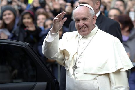 Pope Francis waves as he leaves at the end of his mass at the Church of the Most Holy Name of Jesus in downtown Rome January 3, 2014. REUTER