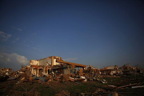 A destroyed home is seen in Joplin, Missouri May 30, 2011. REUTERS/Eric Thayer
