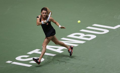 Agnieszka Radwanska of Poland hits a return to Angelique Kerber of Germany during their WTA tennis championships match at Sinan Erdem Dome i
