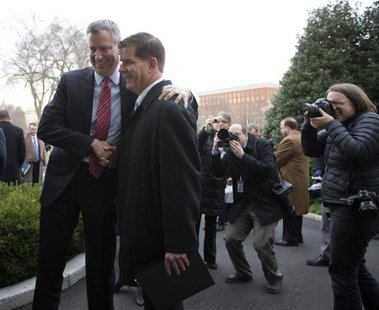 New York Mayor-elect Bill de Blasio (L) and Boston Mayor-elect Martin Walsh are pictured after speaking to the press outside the West Wing o
