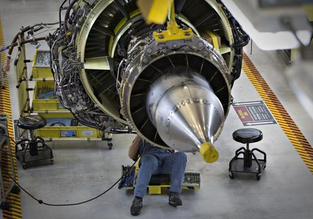 A worker carries out the final preparations on an engine for the Boeing 737-900 at their assembly operations in Renton, Washington, October