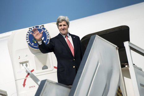 U.S. Secretary of State John Kerry waves as he boards his plane at Ben Gurion International Airport in Tel Aviv January 6, 2014. REUTERS/Bre