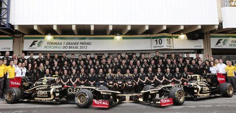 Lotus Formula One team pose during a photo call before the Brazilian F1 Grand Prix at Interlagos circuit in Sao Paulo November 25, 2012. REU