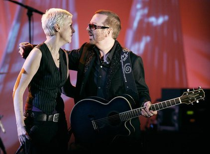 British singer Annie Lennox and Dave Stewart (R), former members of the Eurythmics, embrace after performing at the American Society of Comp