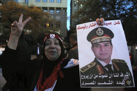 An Egyptian holds an image of Egypt's Army Chief General Abdel Fattah al-Sisi during a protest against what they say is Qatar's backing of o