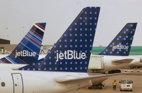 JetBlue Airways aircraft are pictured at departure gates at John F. Kennedy International Airport in New York June 15, 2013. REUTERS/Fred Pr